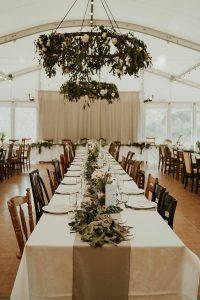 greenery and white flowers wedding bride